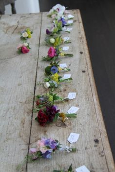 Flower Design Events: Wild Boutonnieres would love these for Groom, Best man, father of the bride and brother of the bride- each buttonhole different but all pulled to match the brides bouquet