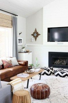 Tips That Help You Get The Best Leather Sofa Deal Fireplace Makeover Ideas loving that brown leather sofa Leather Pouf Ottoman, Best Leather Sofa, Moroccan Leather Pouf, Moroccan Pouf, Pouf Footstool, Poufs, Moroccan Decor Living Room, Living Room Decor, Dining Room