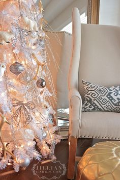 love this white tree with silver branches and gold glitter antlers!