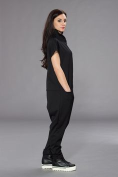 Buttoned Jumpsuit with functional pokets. Perfect fit for a casual walk or a shopping spree.   GREAT GIFT IDEA  ARTICLE: 05C15-00069  MADE OF: