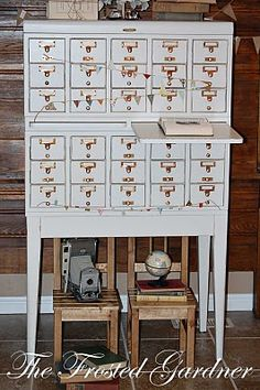 I'm seriously contemplating painting one of my card catalogs and move it into the kitchen for wine storage!