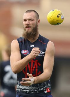 Max Gawn Photos - Jesse Hogan of the Demons handballs during a Melbourne Demons AFL training session at Gosch's Paddock on July 2016 in Melbourne, Australia. Australian Football, July 15, Melbourne Australia, Hairy Men, Demons, Athletes, Ava, Blues, Celebs