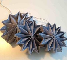 New series 2013 Pleats. 12 point folded gray paper stars.