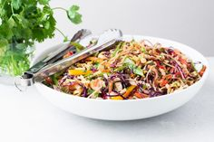 My vegan Asian Slaw with a creamy peanut dressing is a Chinese coleslaw with chow mein noddles that tastes so good you don't even realize how healthy it is. #dressing #best #spicy #creamy #easy #healthy #recipe #asian #chowmein #noodles #potluck #cabbage #vinegar #chicken #sidedish #salad #peanutdressing #vegan #vegetarian #chinese
