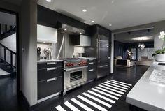 Kitchen with One-wall, Kitchen island, Crate & Barrel Olin Black 2'x6' Runner, Quartz counters, Undermount sink, Flush
