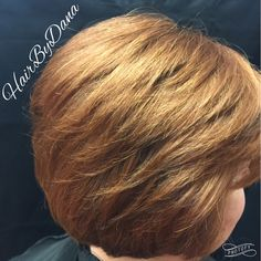Beautiful, natural red color using Redken Color Gels. A slight undercut removed excess bulk at the nape to give this client a flattering layered style.  Hair color and design by Dana