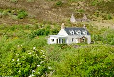 Rosslyn cottage, a permanently-occupied house on the island of Tanera Mor. It is one of ni...