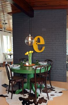 Dark grey, yellow, pendant, wood., love everything with the exception of the cowhide rug.