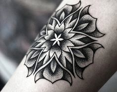 Dotwork black and gray tattoo of Flowers by artist Kamil Czapiga