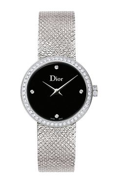 Inspired by an elegant swath of satin ribbon, this brilliant Dior timepiece unifies material opposites, creating a delicate softeness out of something hard.