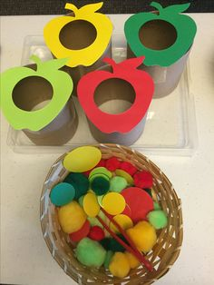 Apple Sorting Activity Begin by cutting out apple shapes. In the example shown, four colors of apples were used: red, green, yellow, light green. Cut a circle from the center of each apple. Attach the apples to cardboard tubes using clear tapes. Collect small objects in colors that match the apples. Invite children to use tongs or tweezers to sort the objects and drop them in to the correct apple.