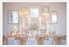 burlap bows on white chivari chairs, candle light, and baby's breath