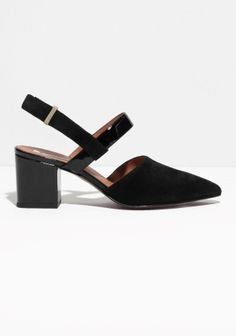 Solid block heels provide sartorial lift and walkability in these refined snakeskin-effect sandalettes featuring a nifty sling back strap with concealed buckle closure.