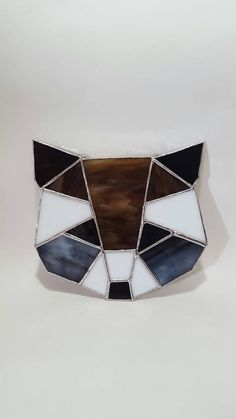 Check out this item in my Etsy shop https://www.etsy.com/listing/267003705/geometric-racoon-stained-glass
