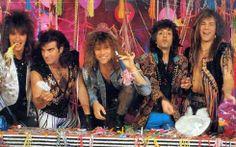 """Bon Jovi - Not sure what they were celebrating here.  Possibly, """"We made another Million each!""""  One of the best hair bands."""