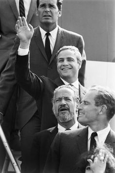 Marlon Brando with James Garner and Charlton Heston. This picture could only be hotter if Dean Martin was in it as well.