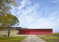 Red mirrors clad Jean Nouvel's addition to a winery
