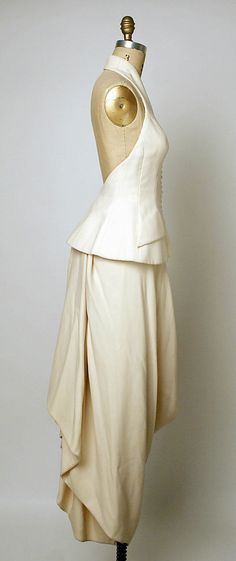 Evening ensemble House of Dior  (French, founded 1947)   Designer: John Galliano (British, born Gibraltar, 1960) Couture Line: House of Dior (French, founded 1947) Date: spring/summer 1998 Culture: French Medium: a) wool, silk; b) wool Sideway