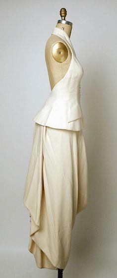 Evening ensemble House of Dior  (French, founded 1947)   Designer: John Galliano (British, born Gibraltar, 1960) Couture Line: House of Dior (French, founded 1947) Date: spring/summer 1998 Culture: French Medium: a) wool, silk; b) wool Sideway