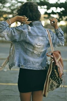 Distressed jean jacket with chains