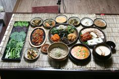 "밥상 Daily meal table. It always includes a rice bowl and lots of 반찬 ""side dishes."""