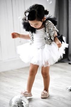 Tutu dress and silver sequined cape