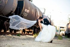 Bride dips by train tracks in Red Wing, MN Photo by Brovado Weddings