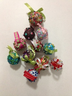 Styrofoam balls, ribbon, buttons, and pins. We made these at our Ladies Craft night.