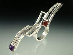 Ring   Danielle Miller-Gilliam 'Mod Slider' Sterling siliver, amethyst, garnet.  The stone settings freely slide back & forth