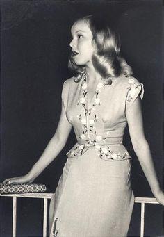 Circa 1940s suit dress peplum floral found photo girl near railing blonde war era vintage fashion style summer dinner cocktail day wear