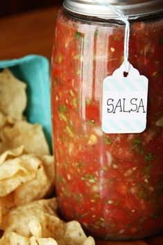 Fresh Salsa. Made with 4lbs of tomatoes from my garden plus a 28 oz strained can of petite diced tomatoes,  2 jalapenos (1 whole, 1 seeded) didn't use the Anaheim pepper but I did add all the spices listed plus an 1/8 tsp of cumin. I processed all of the ingredients to smooth consistency  except the tomatoes, then threw them in and pulsed so it would be somewhat chunky...DELICIOUS!