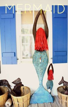 Mermaid Art Sculptures from the Iron Fish Art Gallery are the perfect coastal decor for any beach home. #ironfishart http://www.ironfishart.com/