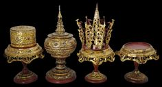 Four-Piece Gilded Lacquer Processional Betel Holders, Burma, circa 1900 hts: 18cm-37cm The set comprises a stand, a betel box on a stand, a domed food container on a stand, and a cone-shaped betel leaf holder (kun-daung) also on a stand. Fraser-Lu (1994, p. 230) says that such sets were used as accoutrements in noviciation processions. Use of spiky betel leaf holders such as the example here formerly was the prerogative of royalty.