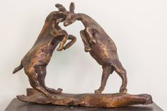 """Bullfighting is a culturally important tradition and a fully developed art form on par with painting, dancing and music, particularly in Spain and Mexico. We present a depiction of 'bull fight"""" for you!  Product id - SC01 Product Description - A """"bull fight"""" statuette in Lost wax, Bronze, Size - 5.5in * 7in *2.5in Artist - Somnath Chakraborty  For enquiries, call or whatsapp to +91 9007798937."""