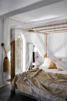I love all the whispy fabric around this bed.  So breezy and romantic.  Ibiza bedroom barefootstyling.com