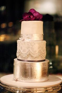 silver and white cake, lace, beads