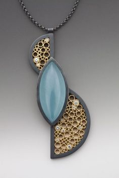 Necklace by Belle Barer. LOVE that gold metalwork! Translate to polymer clay?