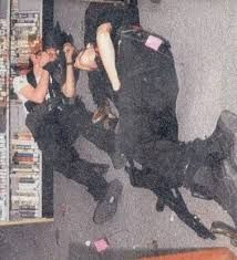these are the deceased bodies of eric harris and dylan klebold-Notice Eric's open head and that his eye has come out of its sochet