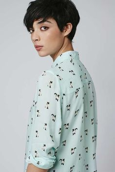 Smart tailoring meets playful prints with this super-cute print shirt. We love the adorable all-over kitty design with contrast buttons and a classic fit. Wear with denim for a casual look.