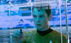 Anton Yelchin playing Chekov in Star Trek using a computer.