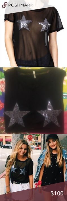 NWOT LF MESH STAR SHIRT BY EMMA AND SAM SUPER RARE From the latest season, many peoples' ISO, very rare and in demand. Never worn and BRAND NEW, never worn! Super cute and trendy! Selling price is to breakeven, I paid $75 with tax but poshmark has fees so only reasonable offers will be entertained. You will get so many compliments and imagine how cute it would be with a cute little black bralette under! LF Tops Blouses