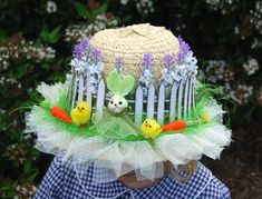 Rustic Look Easter Hat. How to add the rustic flavor to Easter hat? Apply white fence from craft foam and purple lavender above this around the hat. Tie the yellow ribbon into a bow at the back. You can add some other decorations to make this hat more colorful. http://hative.com/cool-easter-bonnet-or-hat-ideas/