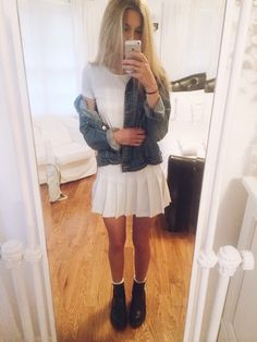 Denim jacket over white dress. Matching white socks.