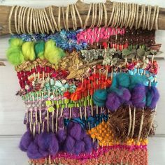 This upcycled woven wall weaving with found objects will make a bold statement in your home! Woven on a crepe myrtle branch are colorful upcycled fabrics from local thrift stores, wool roving, handspun yarns, reclaimed sari silk ribbon and a section of a Trader Joe's shopping bag. Natural items include a piece of tree bark, branch with lichen, and a flattened pinecone. • Colorful Woven Wall Hanging with Found Objects • Materials: Upcycled Fabrics, Reclaimed Sari Silk Ribbon, Wool Roving…