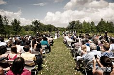 Outdoor wedding ceremony near a pond - by Footstone Photography www.footstonephotography.com