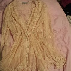 Lace vintage shirt Long sleeve vintage shirt. Super cute with jeans. Worn once for an hour or so. Has a tie in the mid section so if you have a smaller waist it can form to it. Adore Tops Blouses