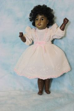 9 inch Kuhnlenz Black German bisque doll with jointed body,nicely dressed !!!