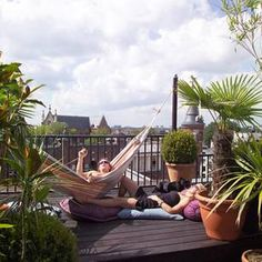 great example of an urban rooftop with a hammock