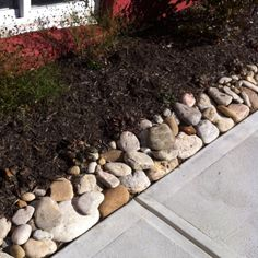 I like the idea of bordering with rocks so the mulch doesn't  get on my walkway.