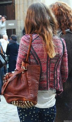love the tweed jacket, especially the detailing on the back.  Not sure how I feel about the rest of the outfit (mesh, studs, dots), there's alot going on!